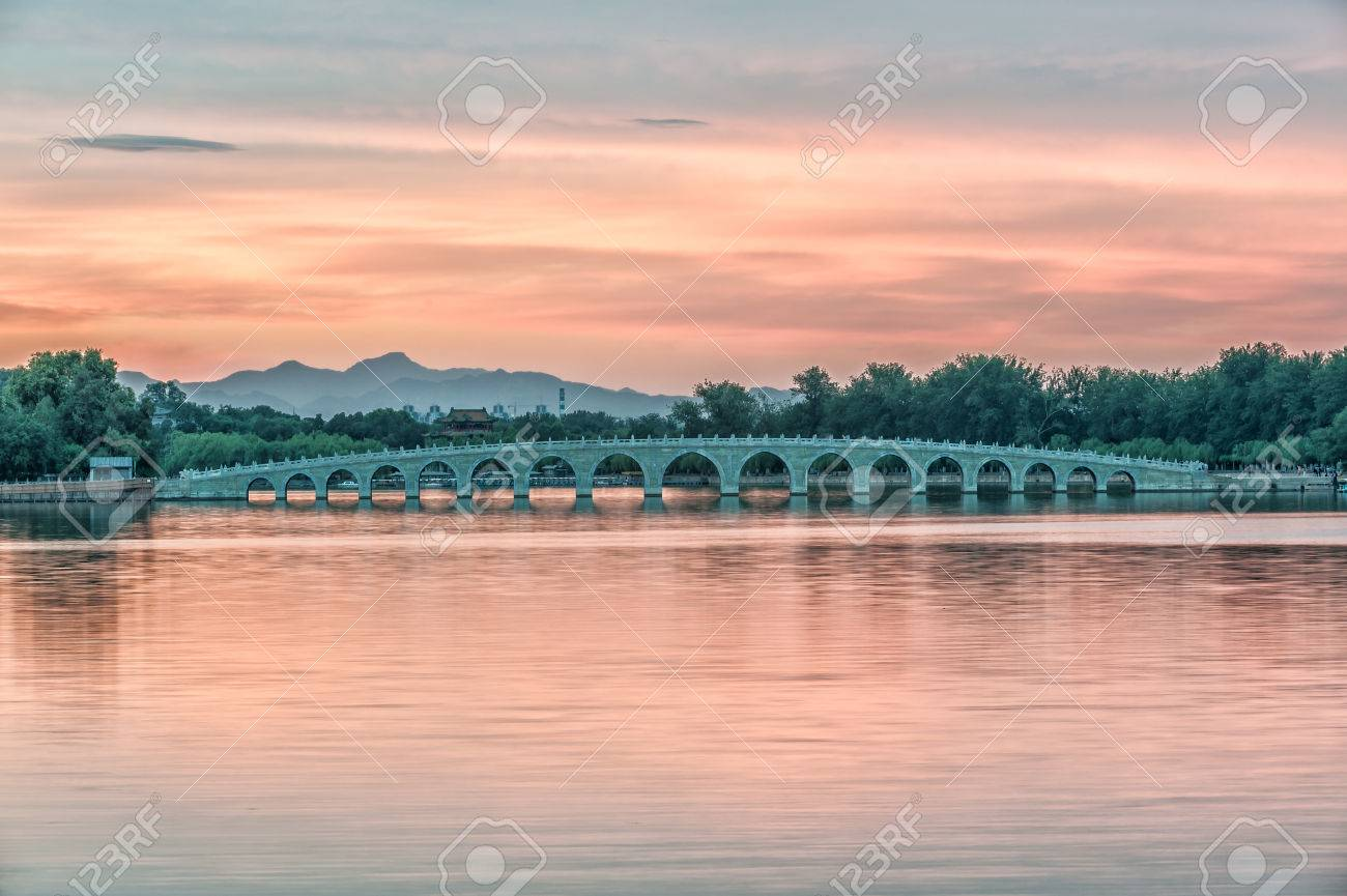 The Famous 17 arch lion bridge in Summer Palace under the sunset