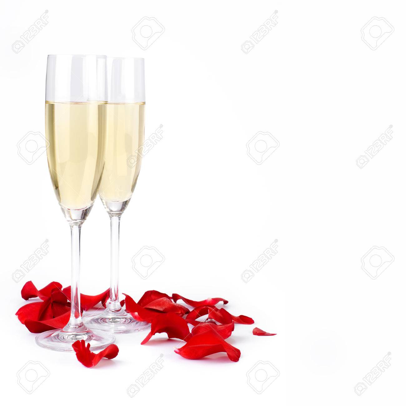 Decoration With Rose Petals And Champagne On A White Stock Photo