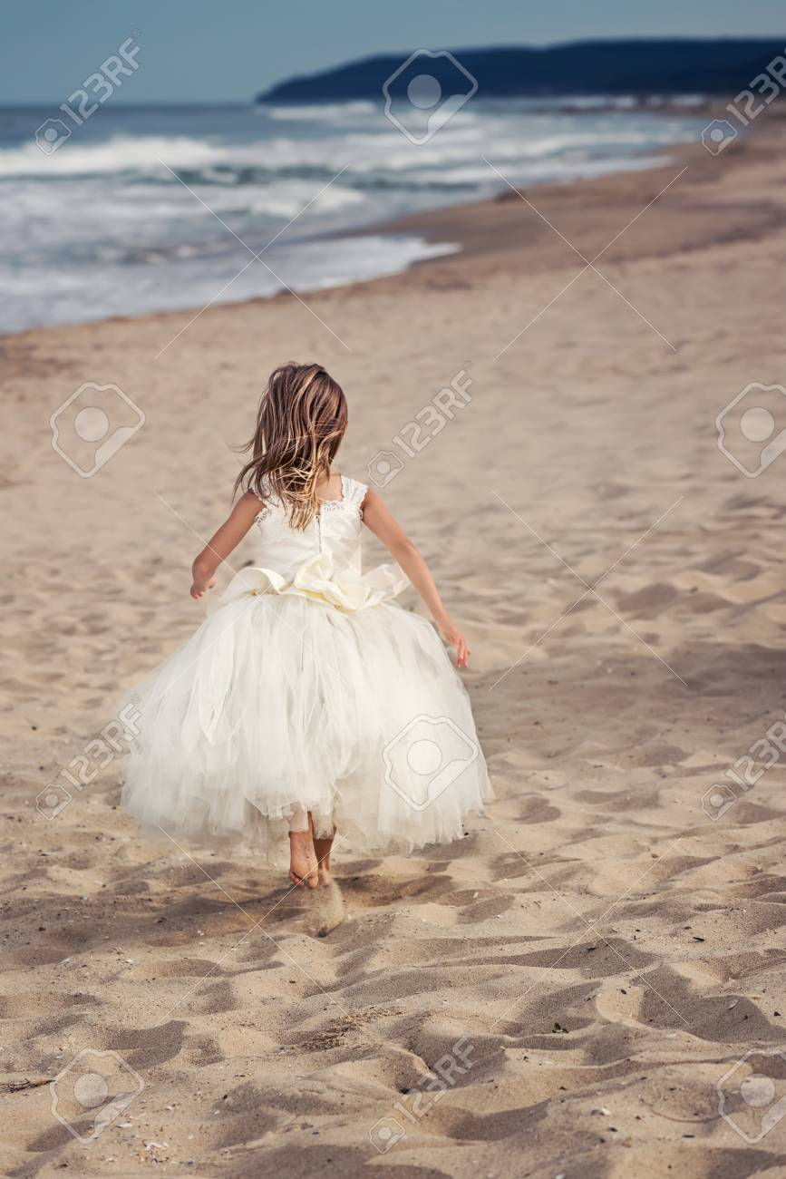 Walk On The Beach / Beautiful Little Girl In A White Dress On.. Stock  Photo, Picture And Royalty Free Image. Image 94203037.