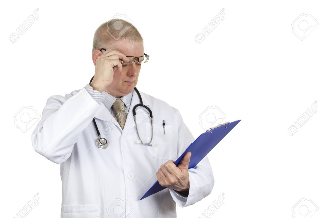 Doctor In White Coat And Stethoscope Raising His Glasses To Check ...