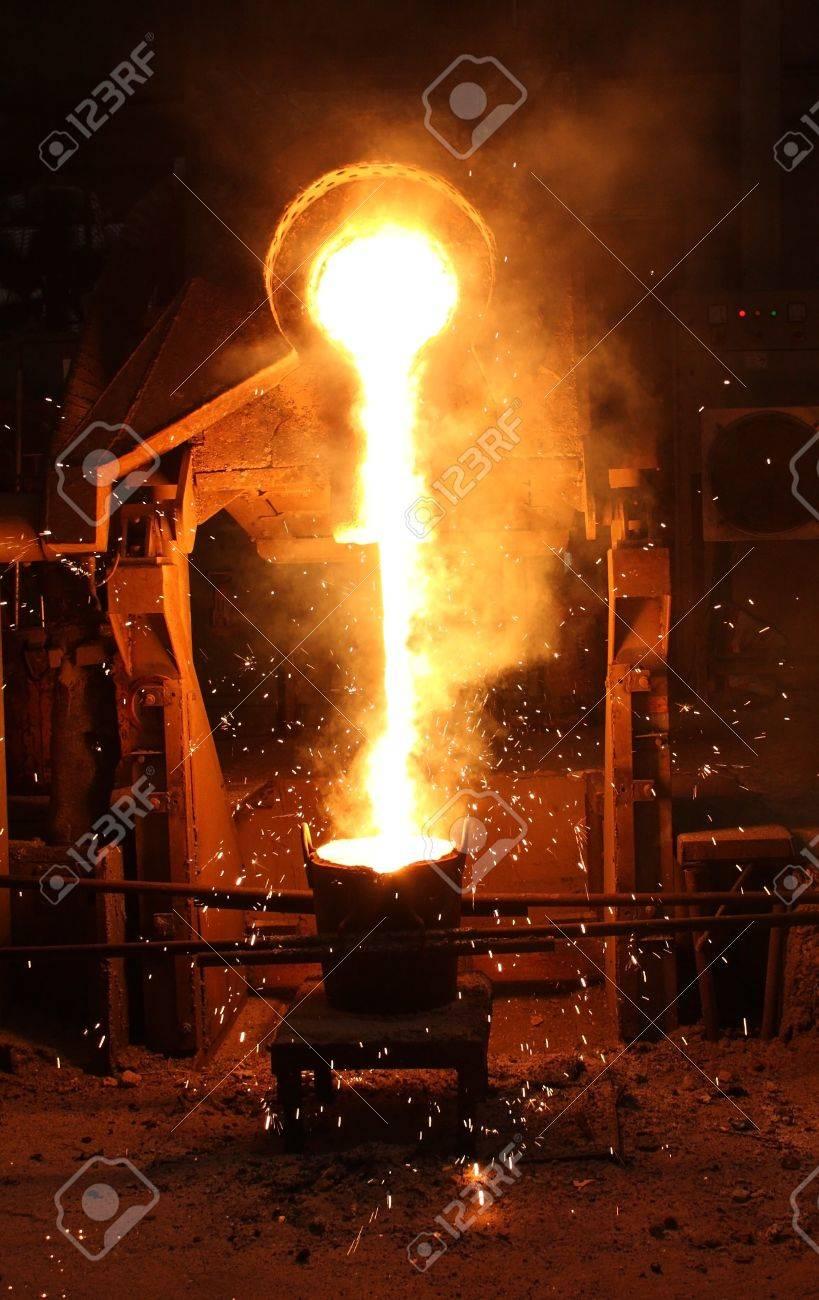Liquid metal from casting ladle  Ferrous metallurgy  Stock Photo - 12754363