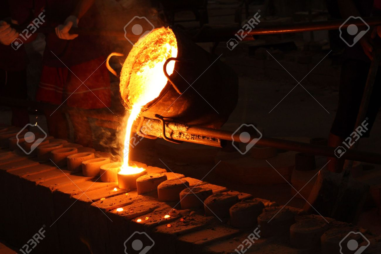 casting metal. molten metal poured from ladle for casting stock photo - 13512713