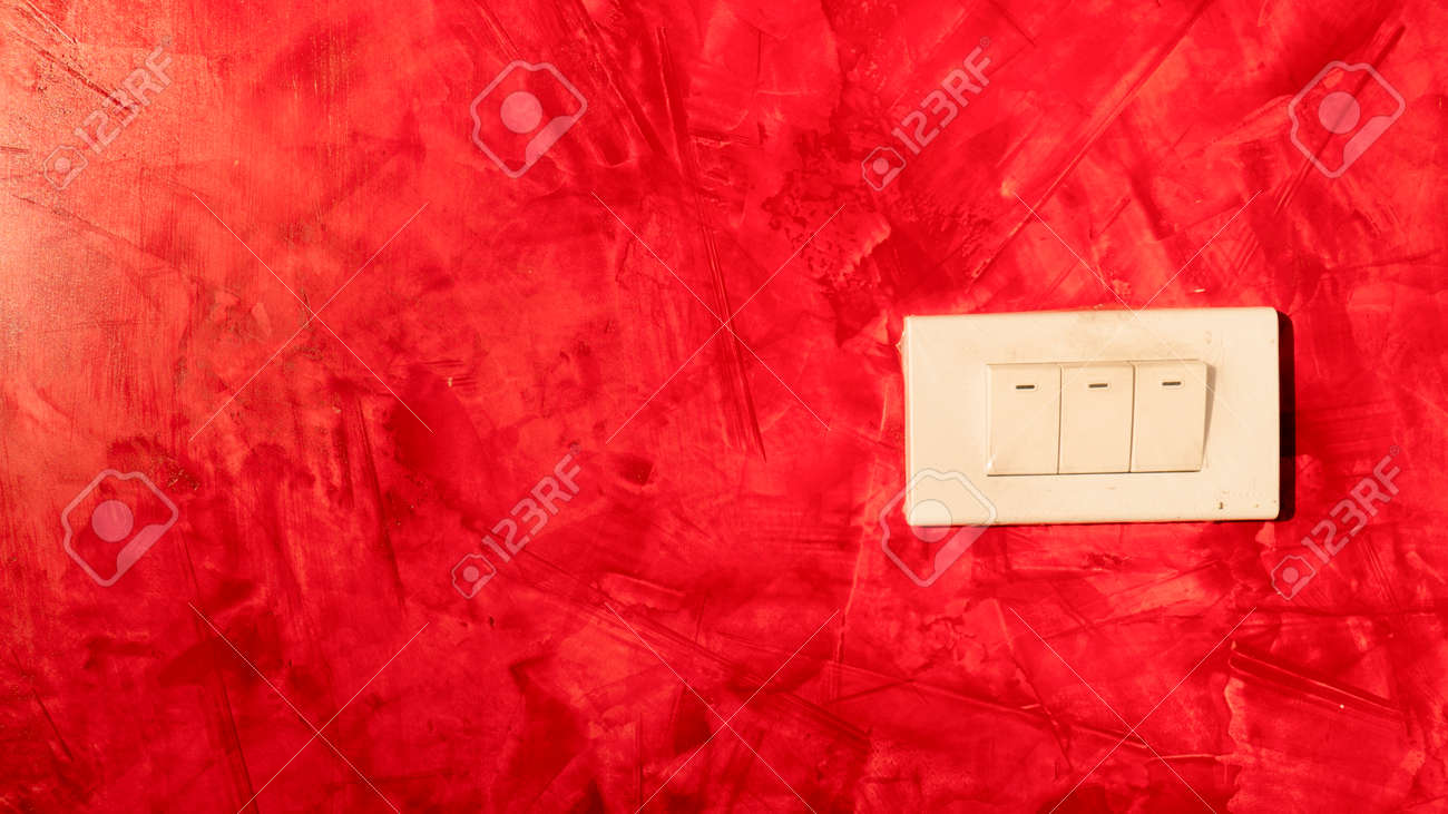 Red painted loft walls and light switches. - 164389378