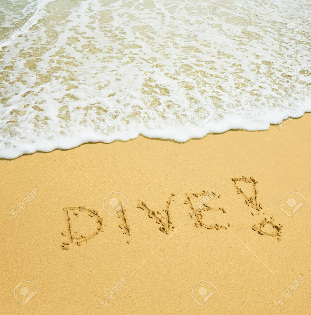 dive written in a sandy tropical beach Stock Photo - 2665244