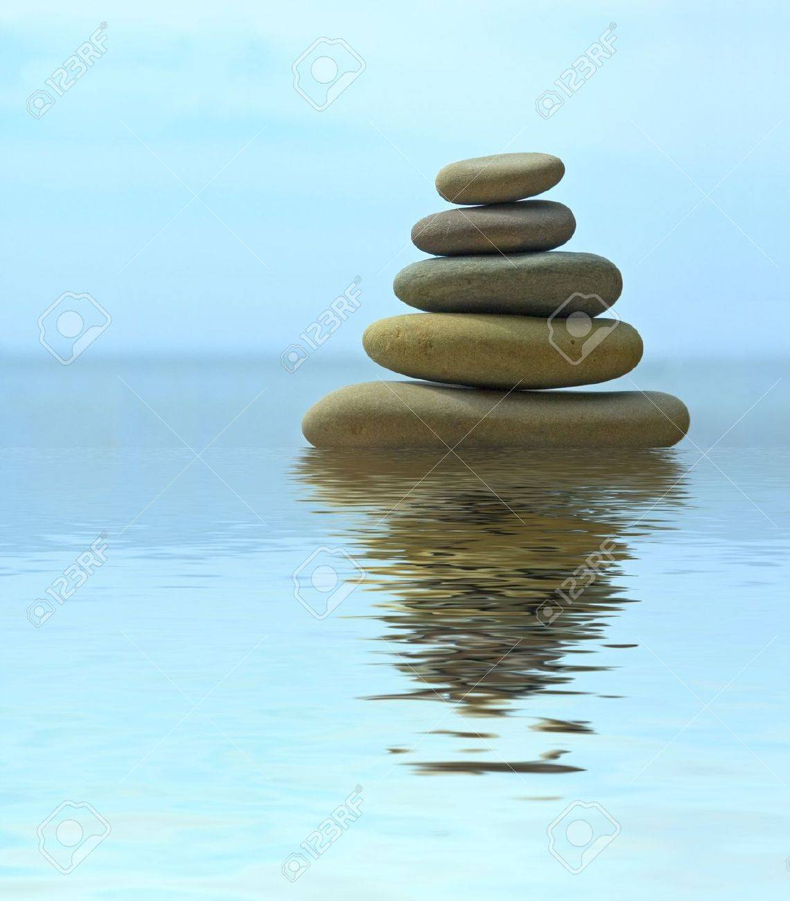 Pebble stack reflecting in the water Stock Photo - 3057623