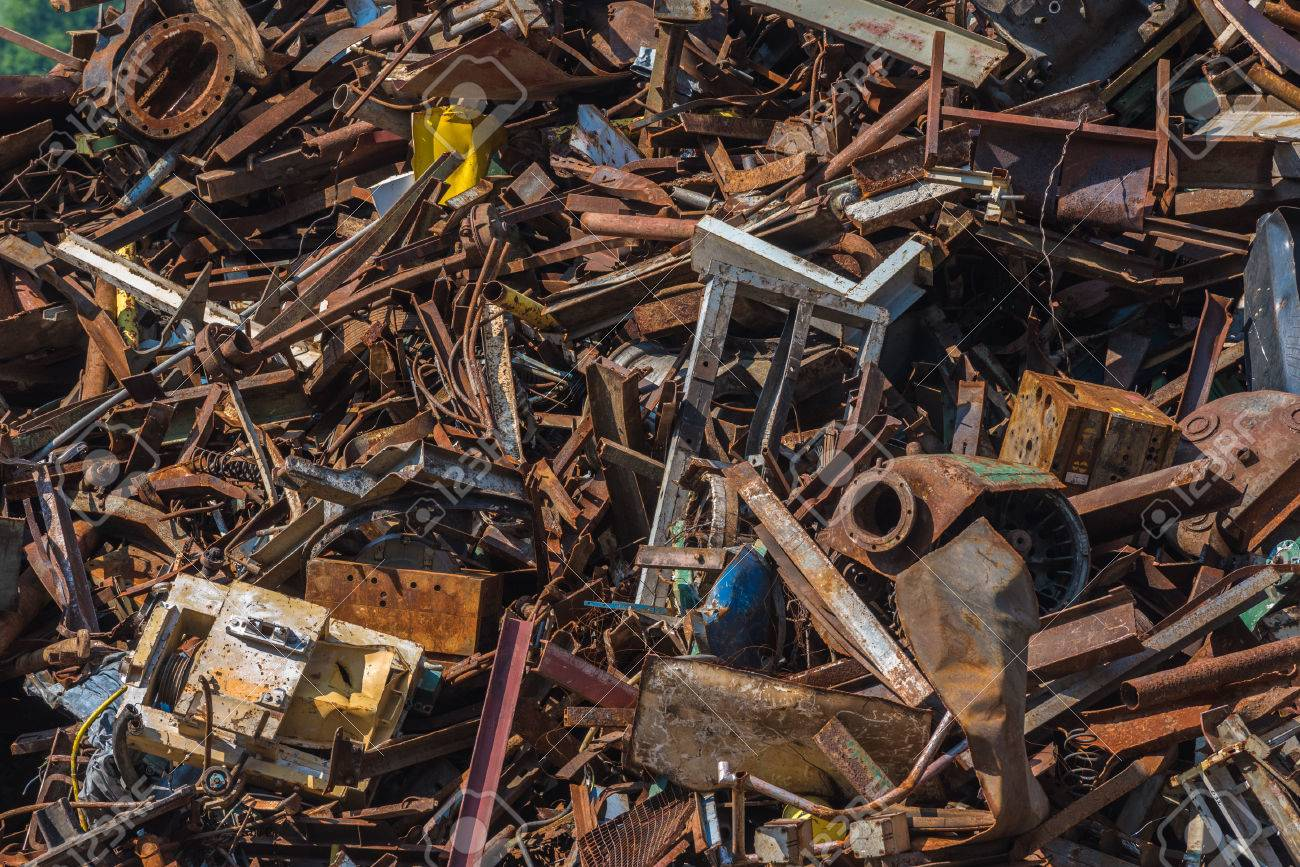 Scrap metal waste in a recycling yard - 53917170