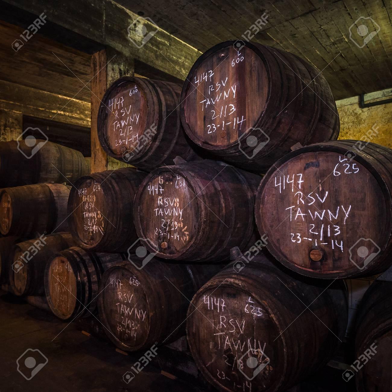 Port wine barrels in cellar, Vila Nova de Gaia, Porto, Portugal - 96074334