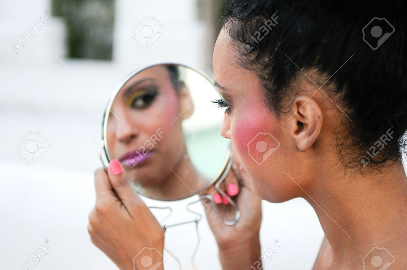 Portrait of beautiful black girl with mirror Stock Photo - 16653471
