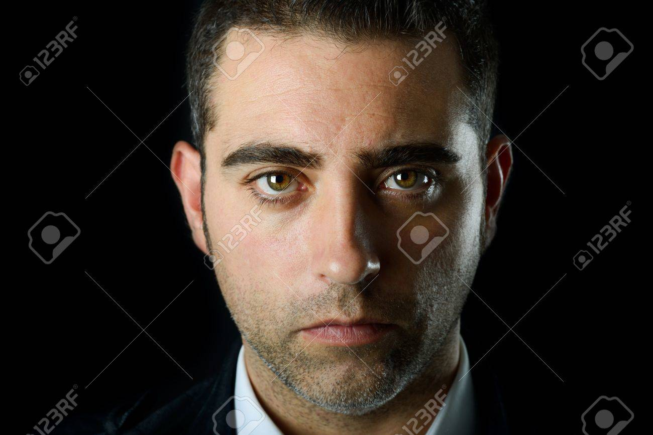 Close up studio portrait of a serious man on black background Stock Photo - 16826132