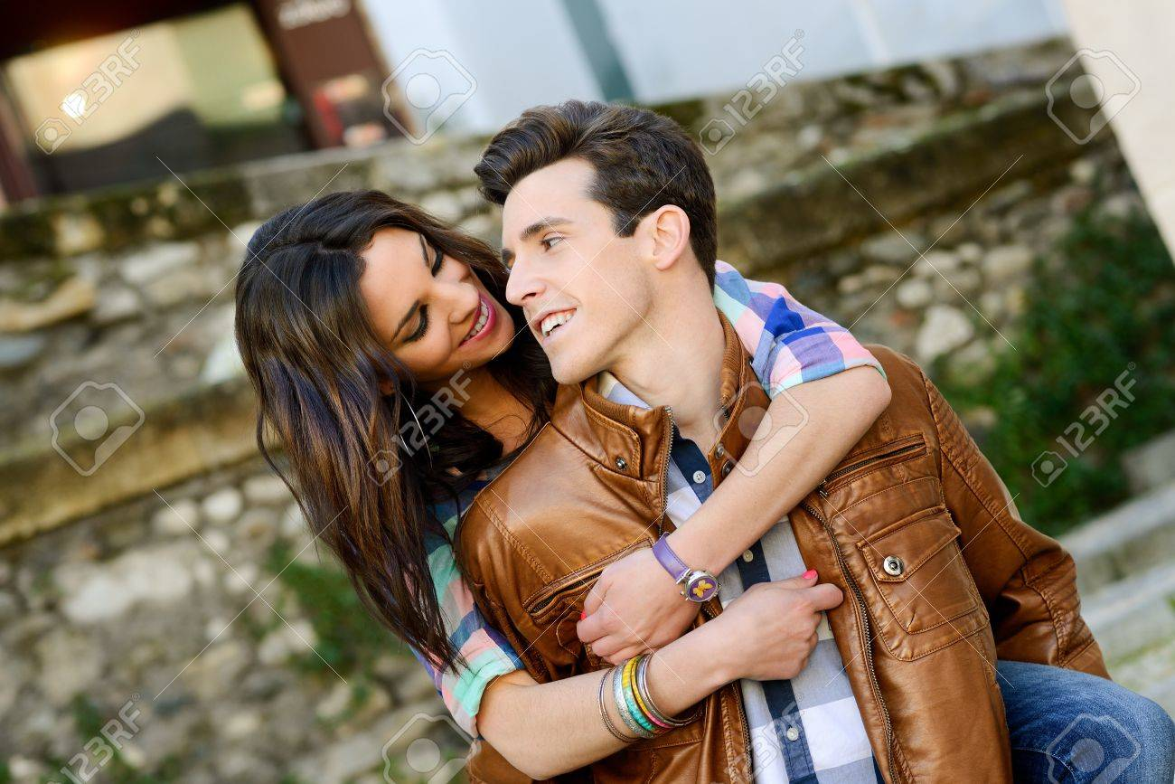 Portrait of a cheerful young couple on a city street Stock Photo - 17803168
