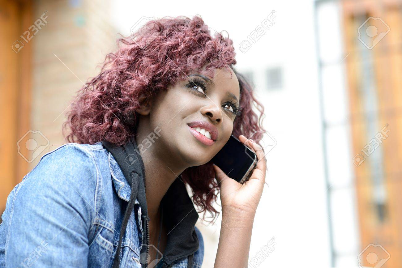 Portrait of beautiful black woman in urban background on the phone Stock Photo - 18940000