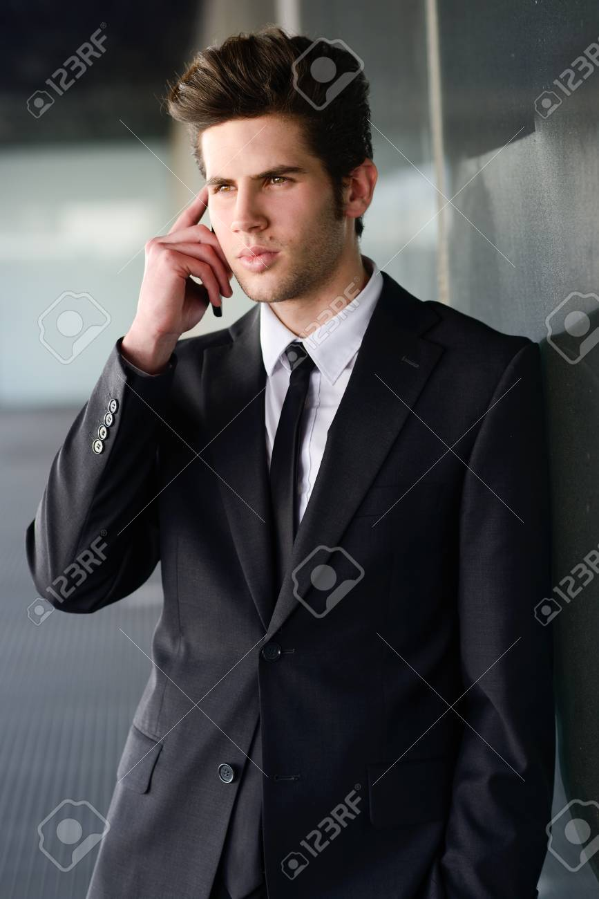Portrait of an attractive young businessman on the phone in an office building Stock Photo - 22482408
