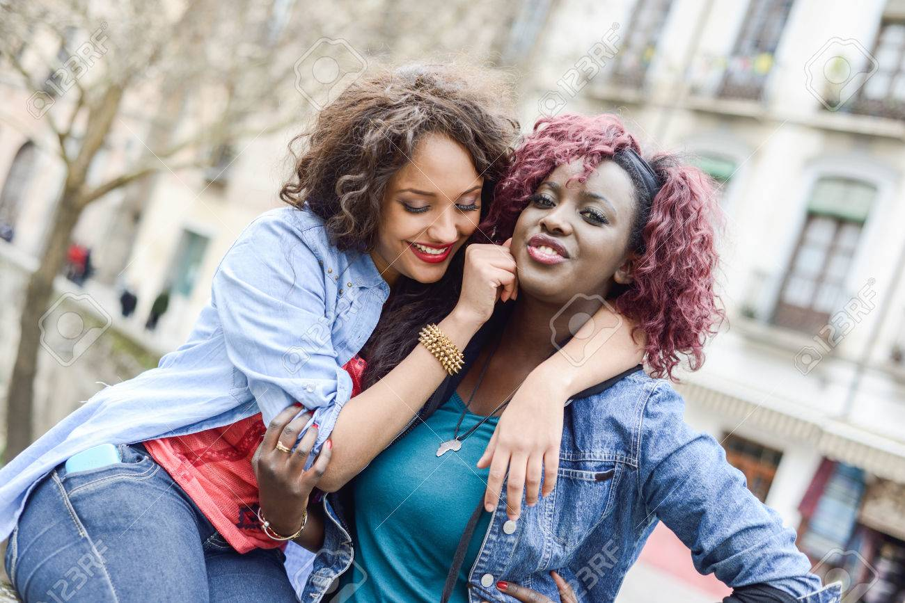 portrait of two beautiful girls in urban backgrund black and