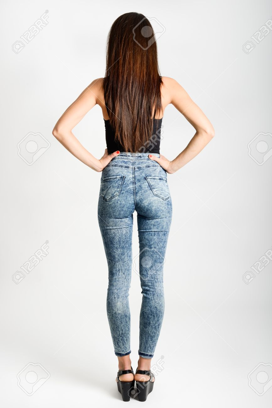 Back Side Of Woman Wearing High-waisted Jeans. Studio Shot. Girl ...