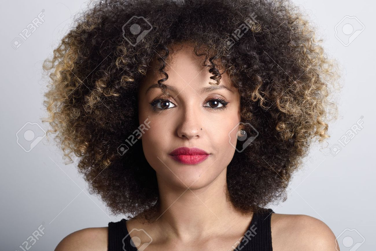 young black woman with afro hairstyle on white background girl