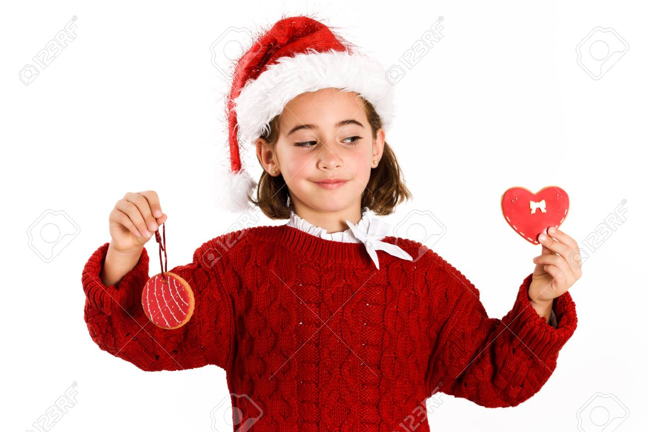 b0b30c86f Adorable Little Girl Wearing Santa Hat With Christmas Cookies ...