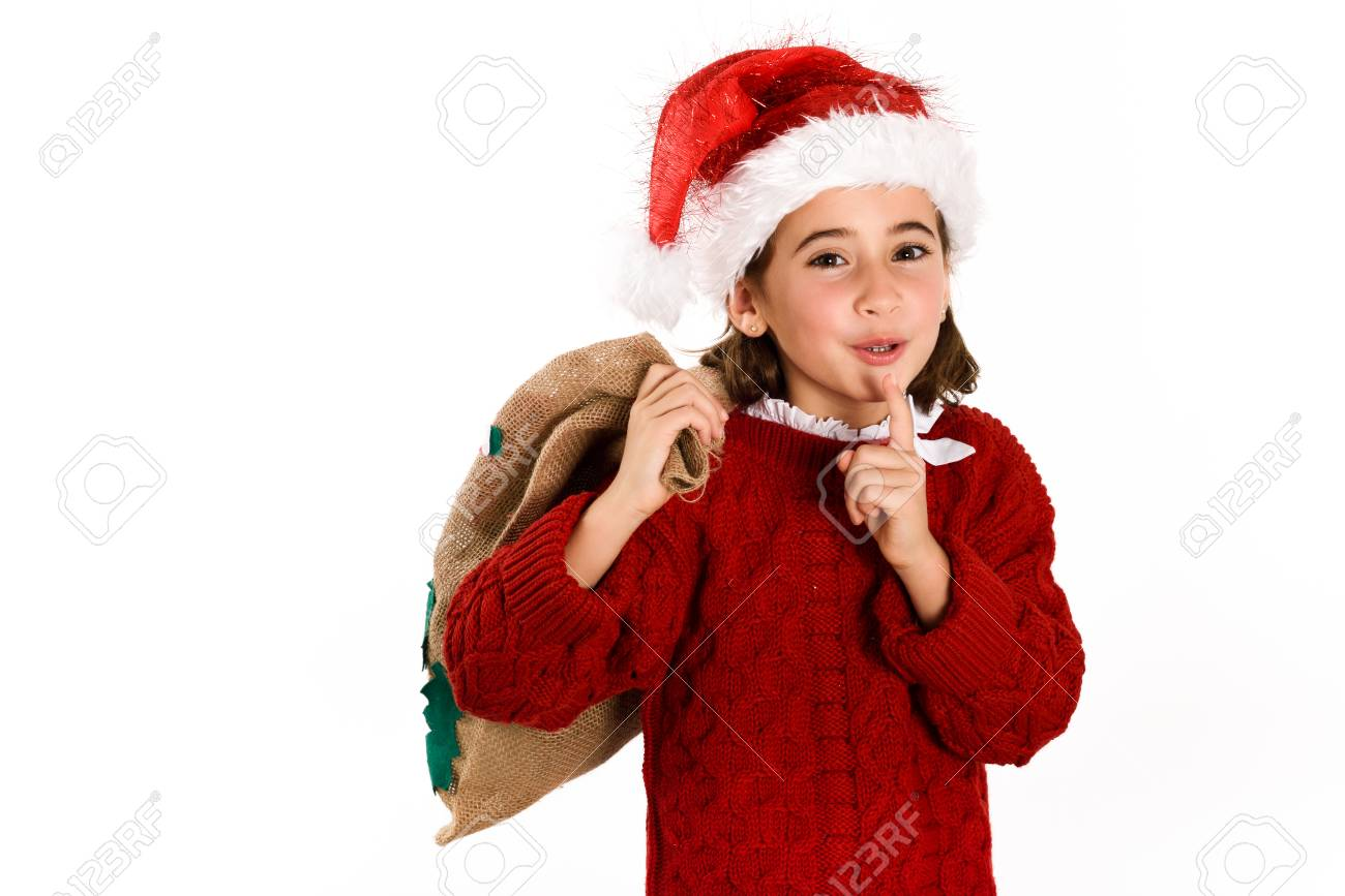 04e0a9b89b96 Adorable little girl wearing santa hat carrying gift bag isolated on white  background. Winter clothes