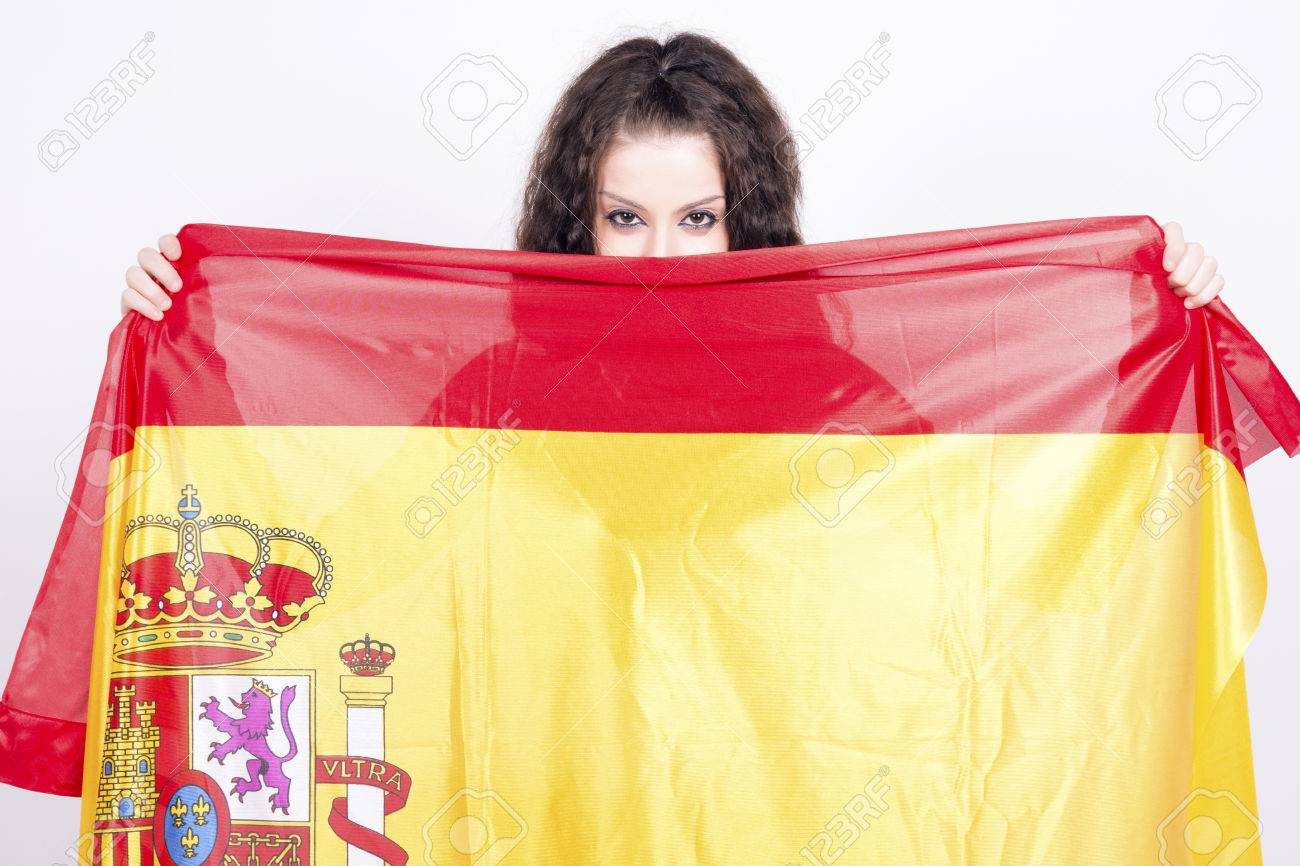 Woman playing with a spanish flag, hiding behind  She is a Spain