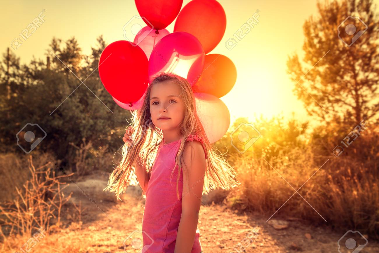 Portrait if little girl with balloons stock photo 71250730