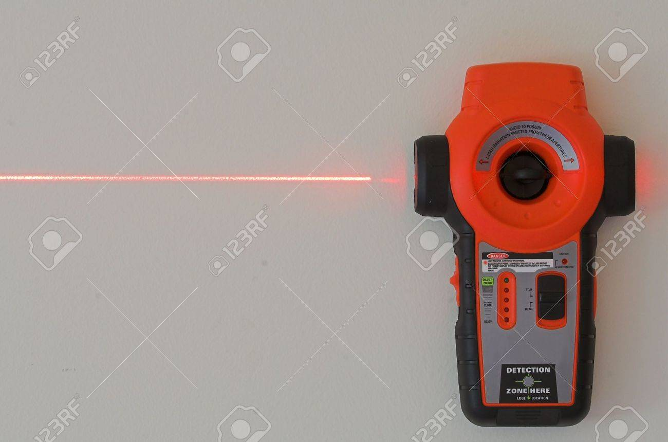 Laser Level Hanging On Wall With Laser Beam Stock Photo Picture And