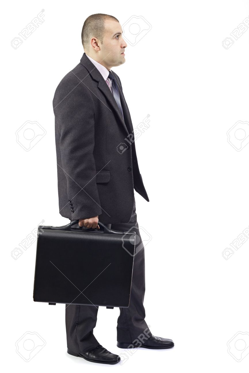 Side view of an adult business man in his way to the workplace,carrying the suitcase Stock Photo - 12964445