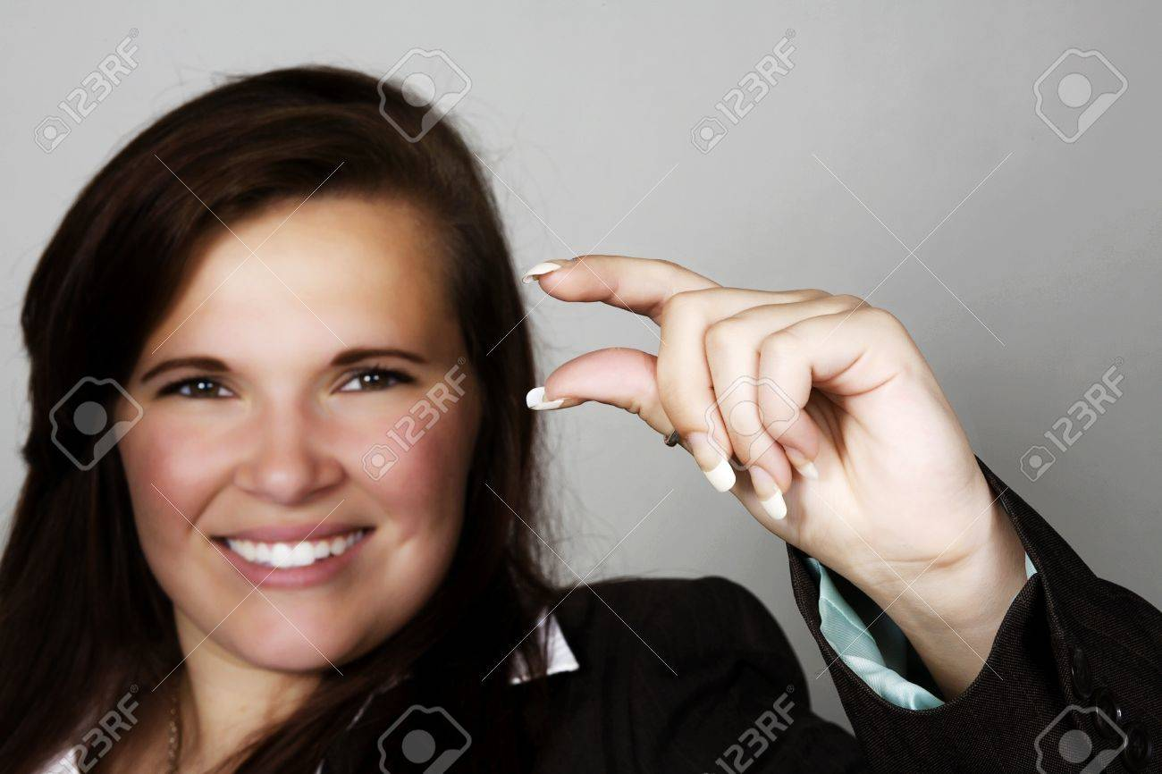 woman with hands up as if holding something between her fingers Stock Photo - 11699885