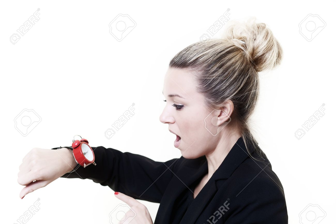 woman in a suit looking at a wrist watch made to look like a stock