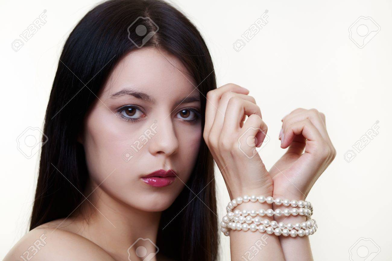 Stock Photo  Young Woman With A Pearl Necklace Wrapped Around Both Wrists  As If She Was Tie Up
