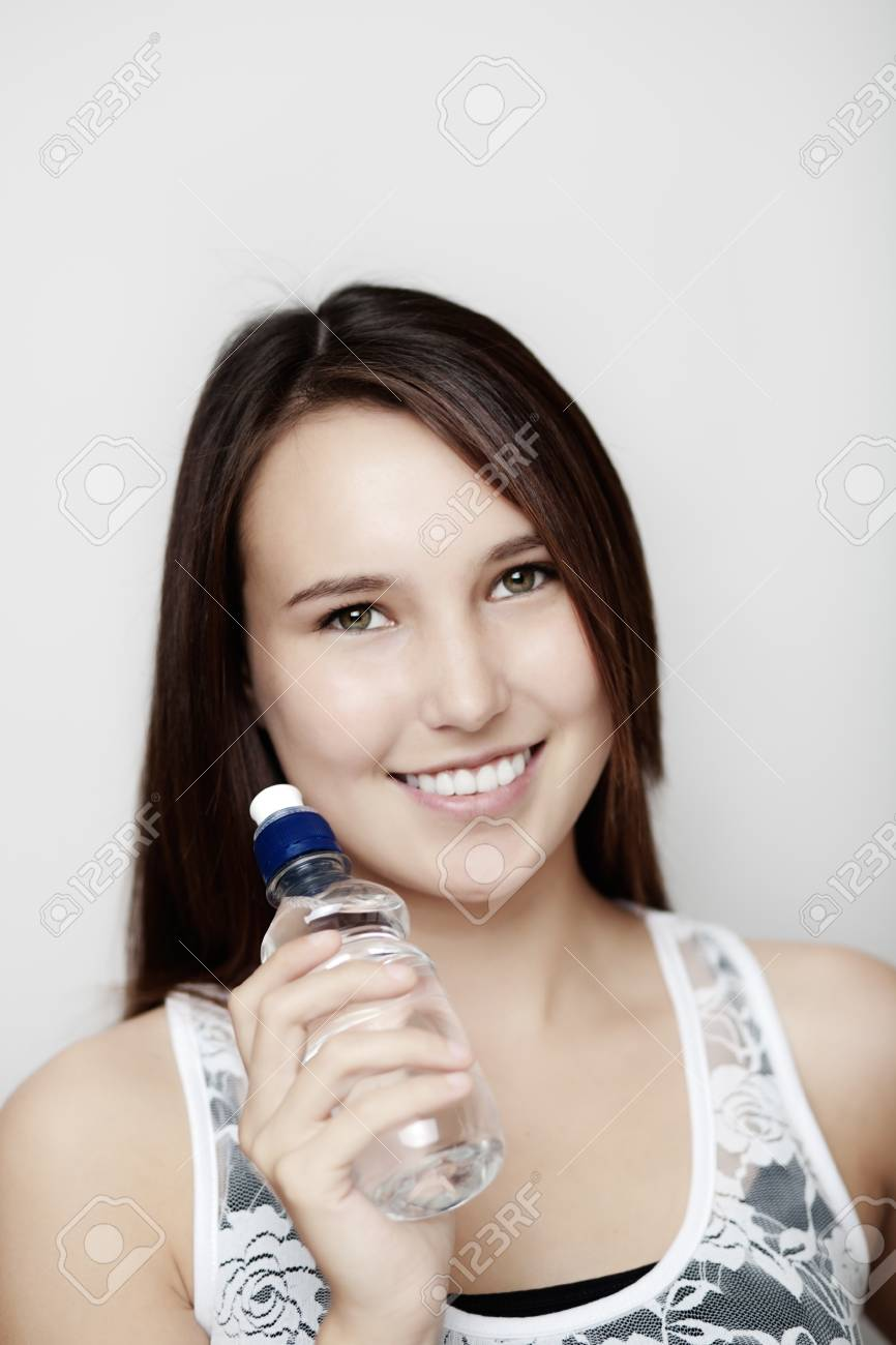 young girl keeping hydrated with a bottle of water Stock Photo - 14477697