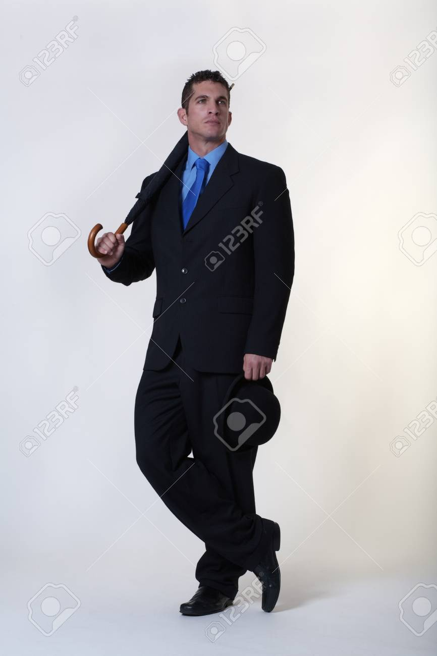 0027ca487c9 classic style businessman with a holding a bowler hat and umbrella Stock  Photo - 15708188