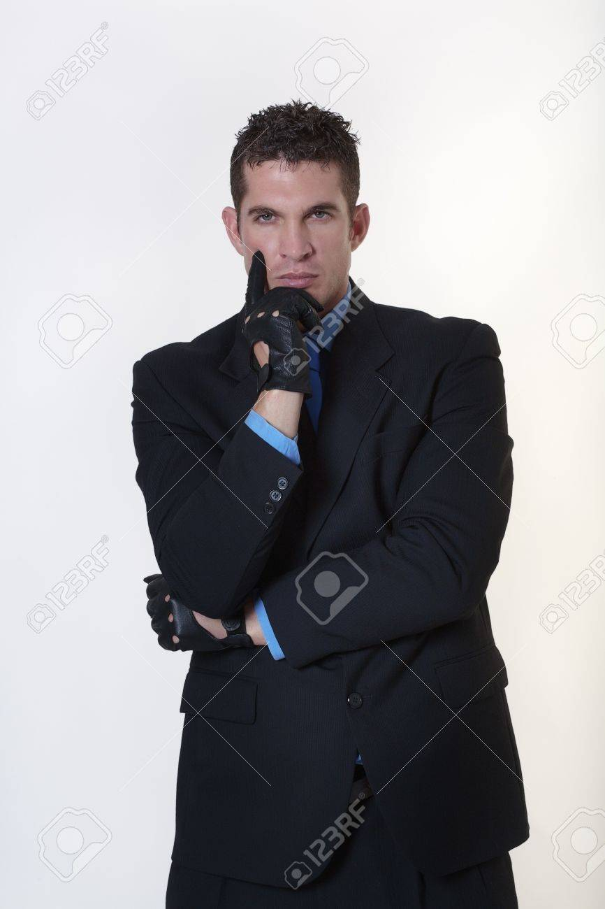 hard looking man wearing gloves not someone to be trifled with Stock Photo - 15708204