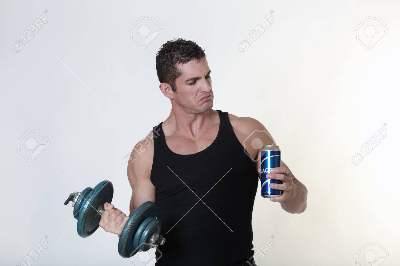 male bodybuilder not sure if he should have a drink of beer or carry on with his work out Stock Photo - 15811533