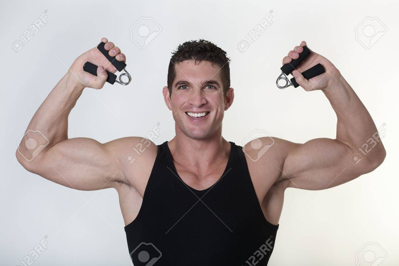 good looking male bodybuilder using hand gripper Stock Photo - 15811586