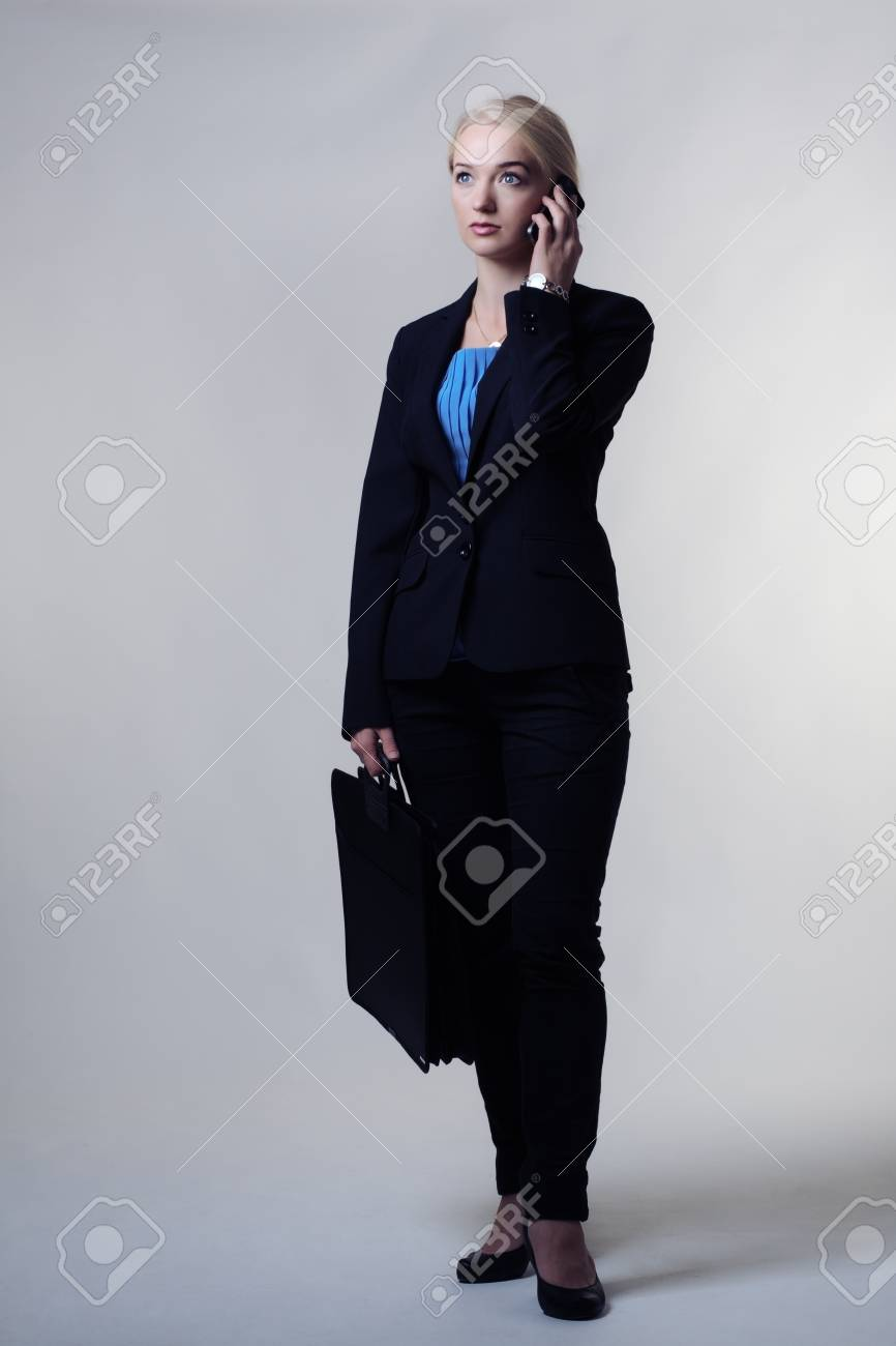 young smart business woman on her mobile phone Stock Photo - 16117388