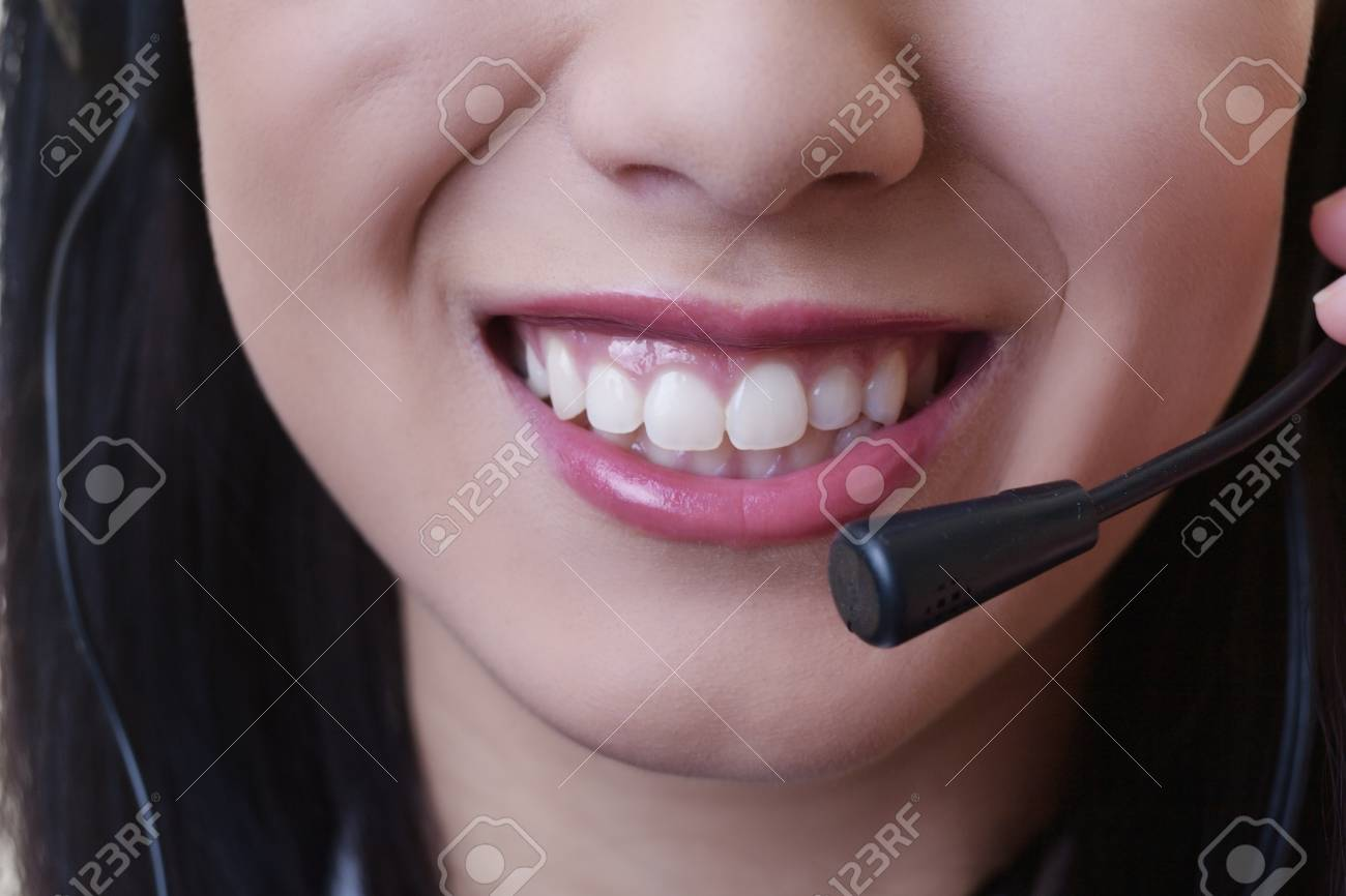 close up of a woman mouth using a phone headset to talk Stock Photo - 17456513