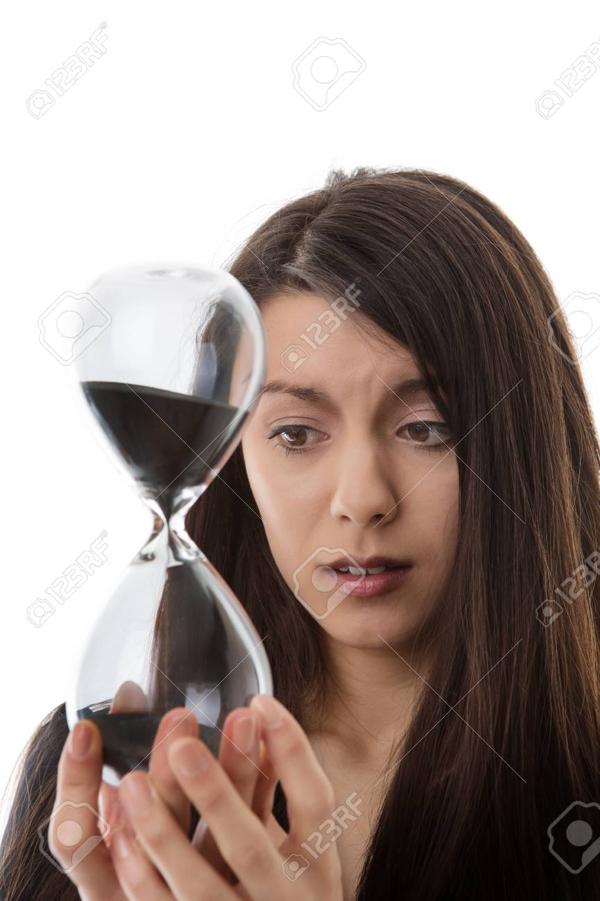 Woman Holding Up A Hour Glass Sand Timer Watching Time Slip Away