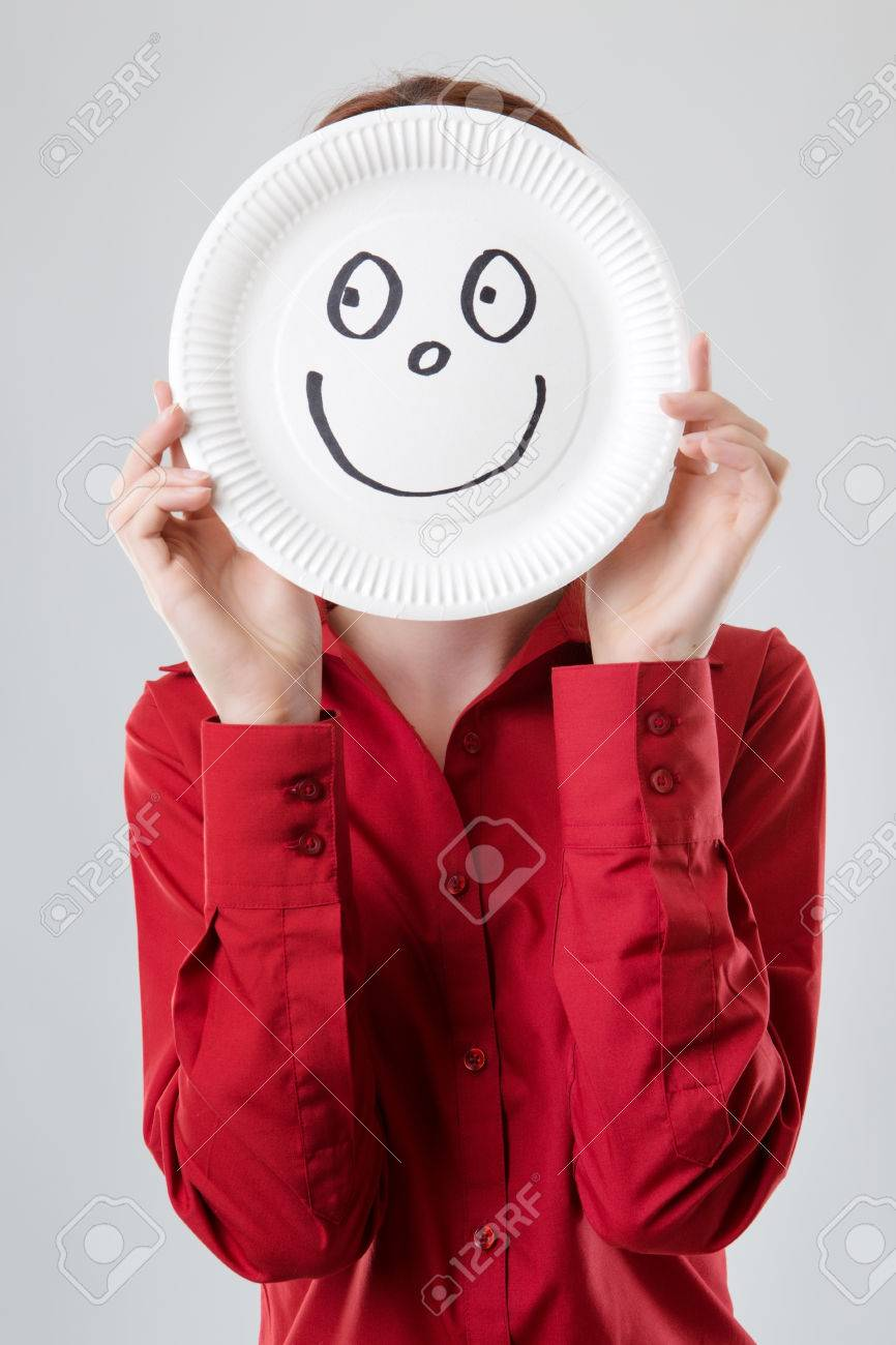 business woman holding a paper plate up to her face with a happy face drawn on & Business Woman Holding A Paper Plate Up To Her Face With A Happy ...