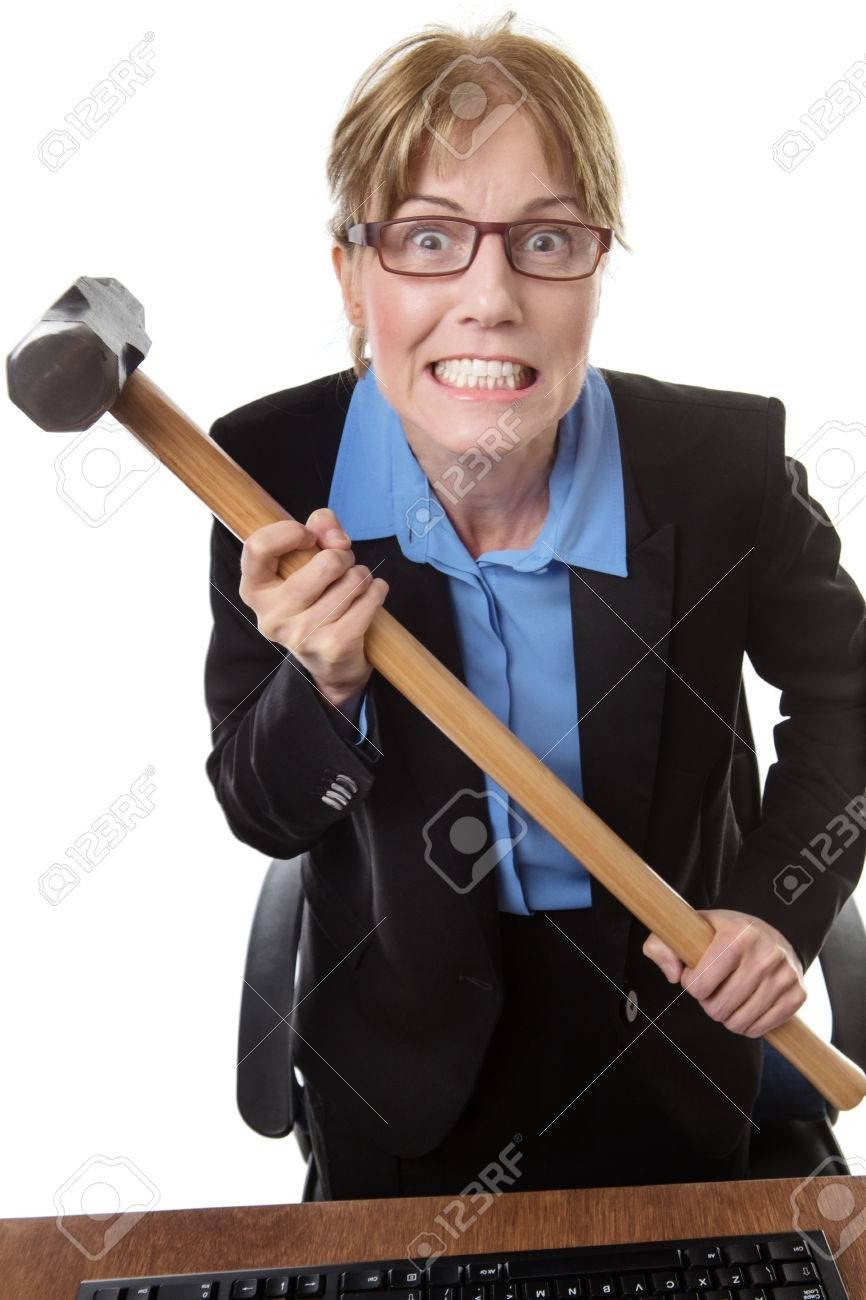 Frustrated office worker on the phone holding stock photo image - Stock Photo Frustrated Office Worker Is Holding A Sledgehammer Poised Ready To Smash Into Her Keyboard