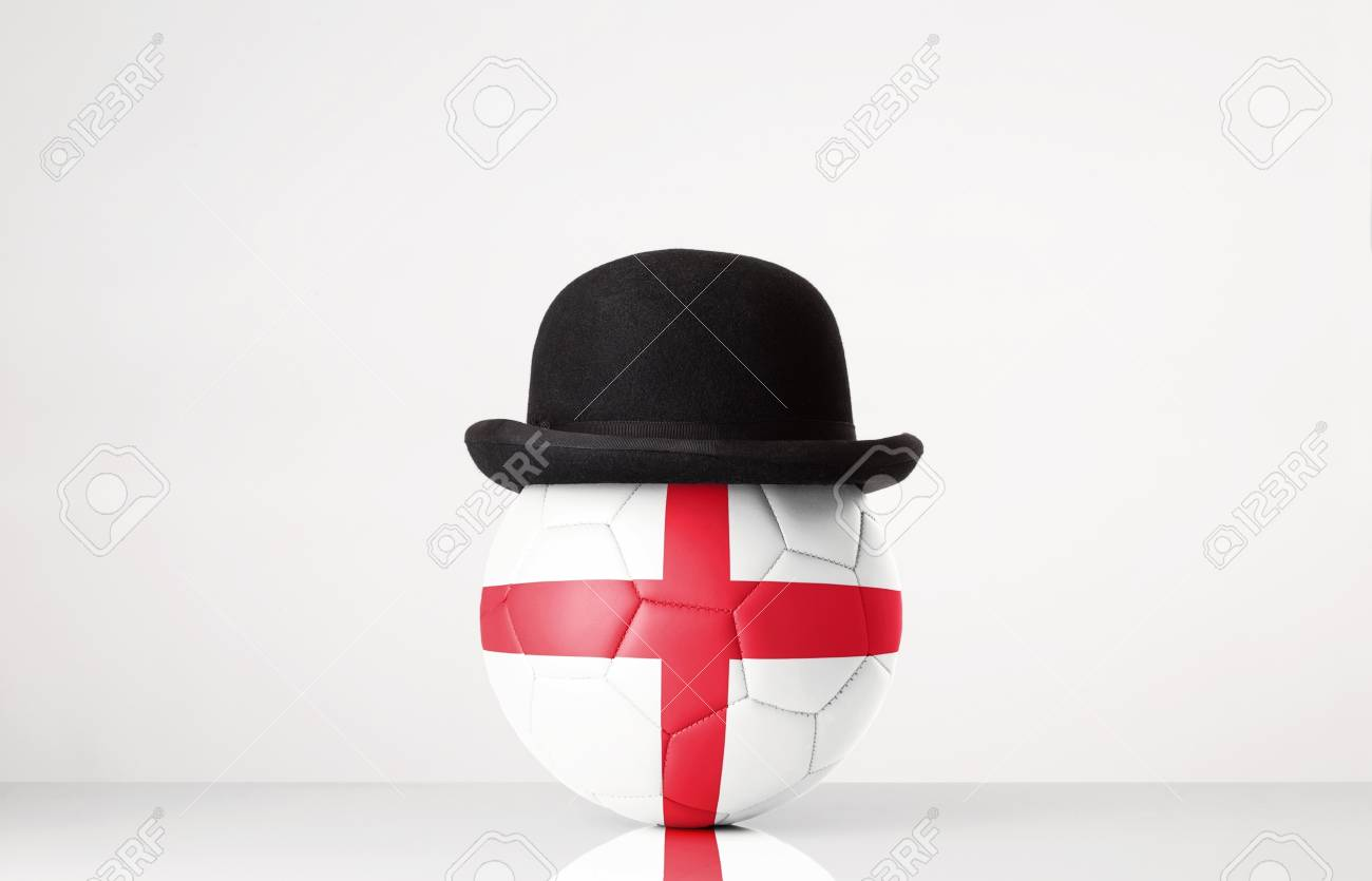 still life image of football wearing a bowler hat with England flag  superimposed on football Stock c27fb88116fb