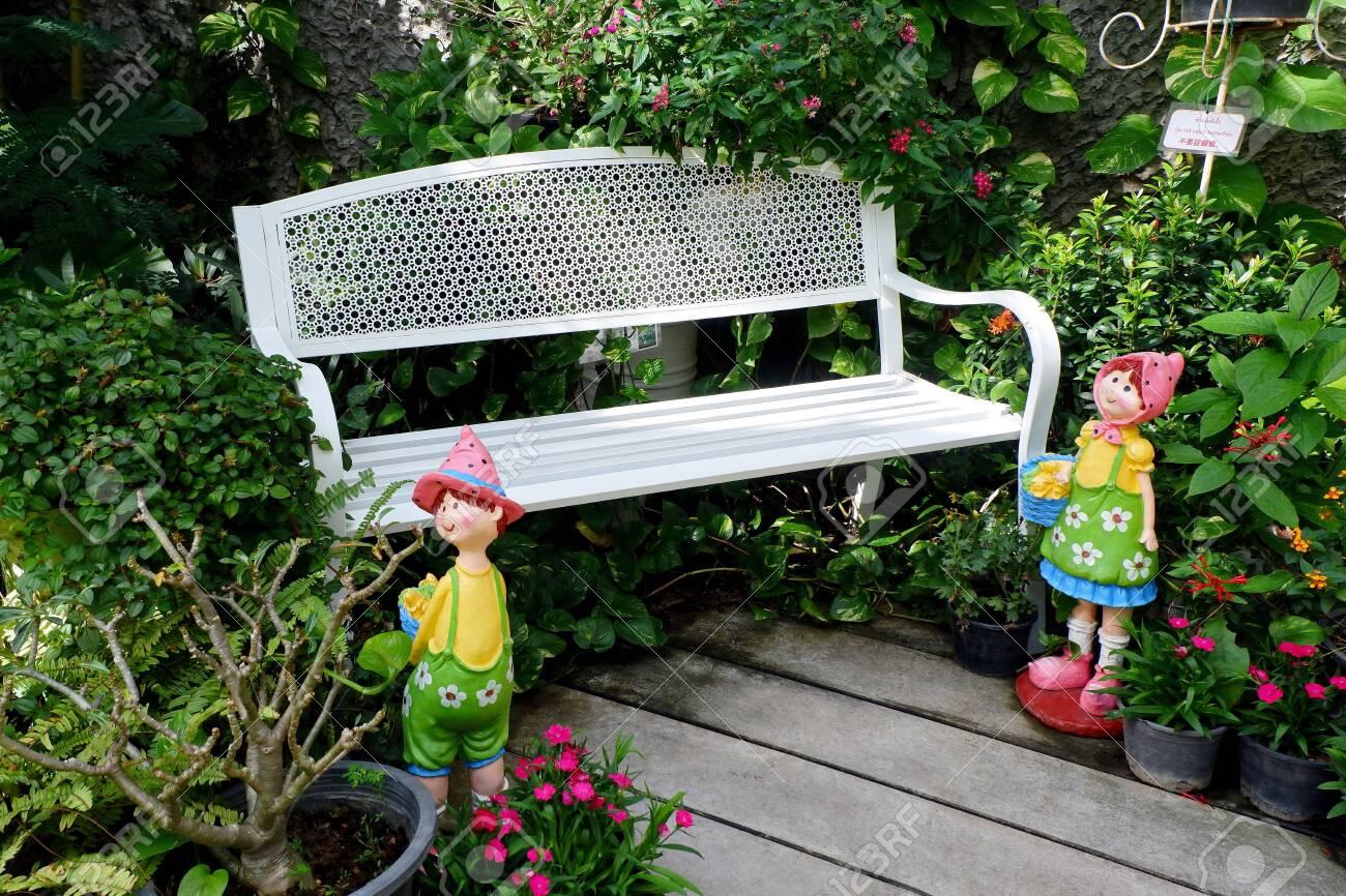 Terrific Outdoor White Metal Bench Isolated In The Garden Machost Co Dining Chair Design Ideas Machostcouk