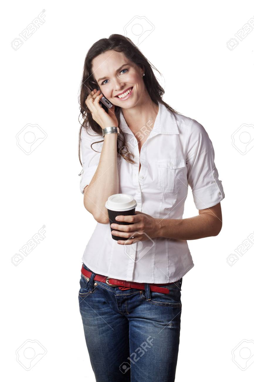 A lovely portrait of a casual beautiful woman talking on the phone and holding a take away coffee. Isolated over white. Stock Photo - 7221360