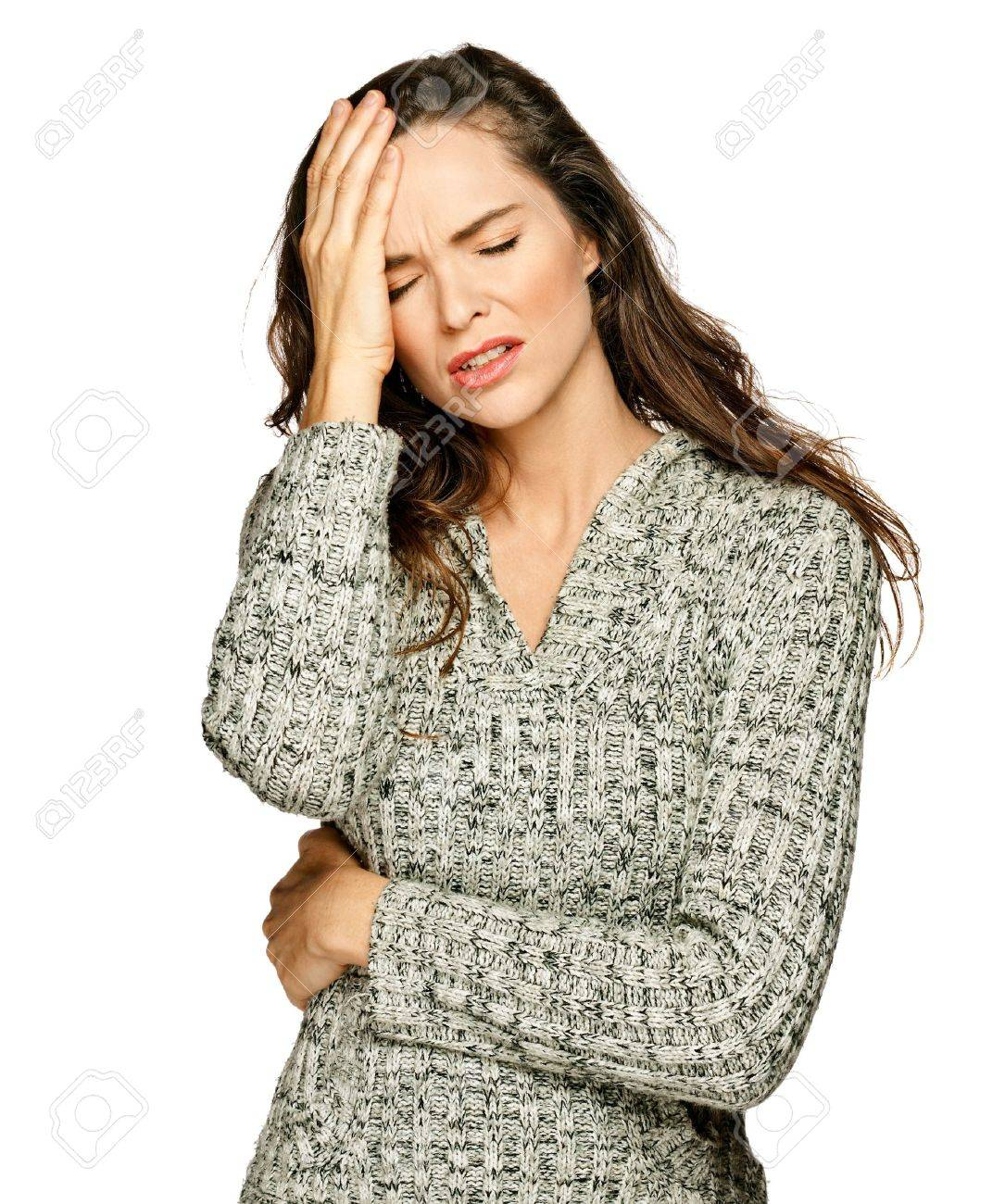 A young attractive woman suffering from illness or headache holding her head. Isolateed on white. Stock Photo - 7648858