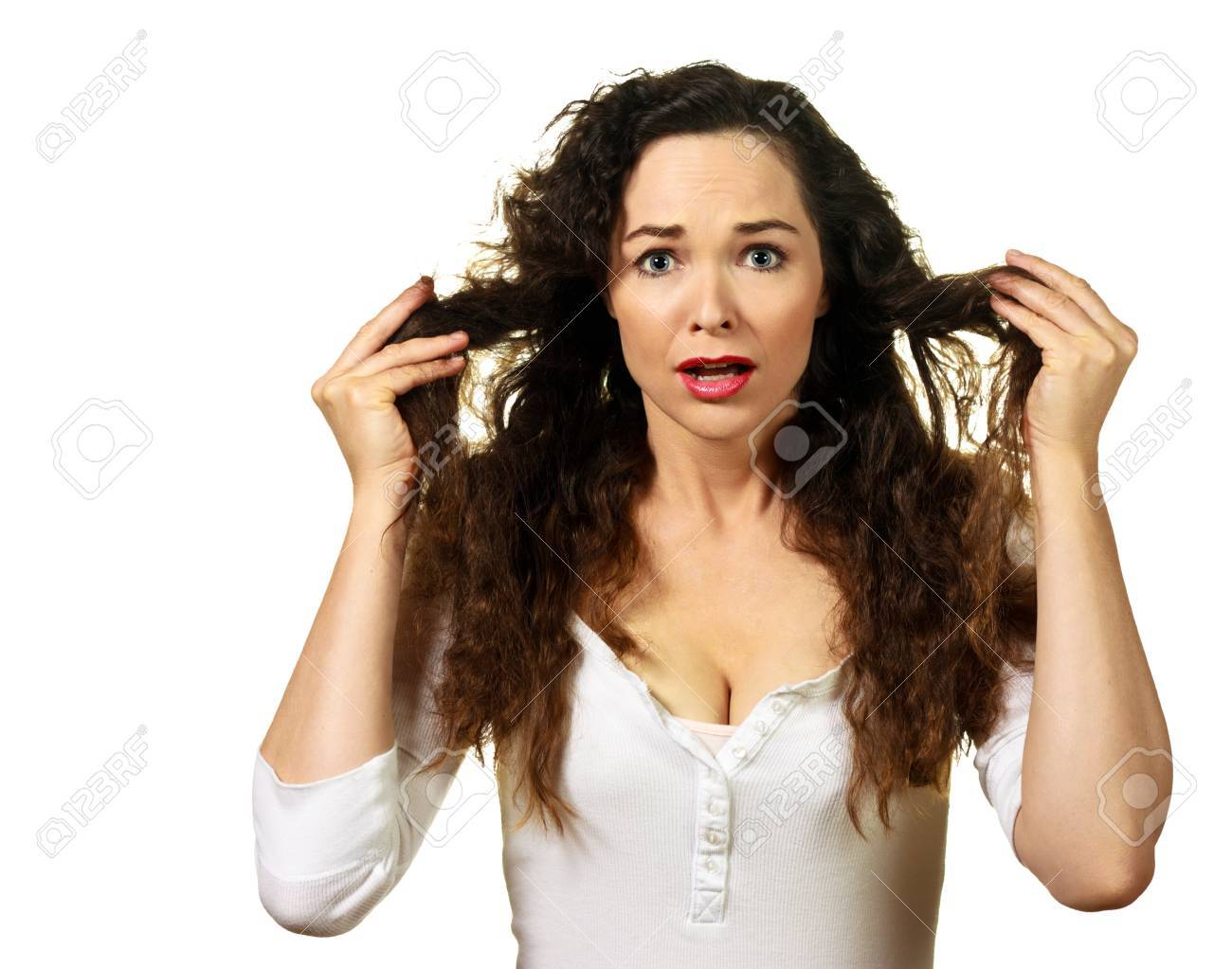 Isolated portrait of a beautiful young woman having a bad hair day - 9255136