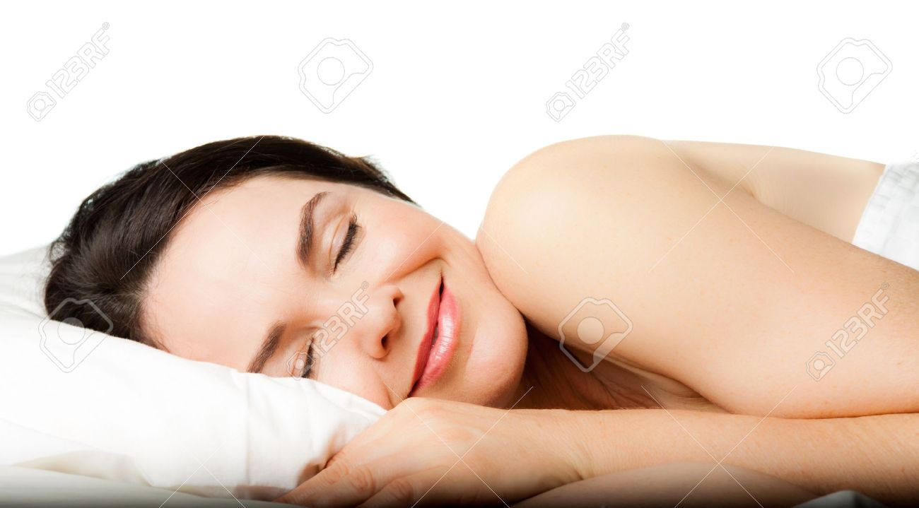 A beautiful young woman sleeping peacefully  Isolated over white Stock Photo - 13892471