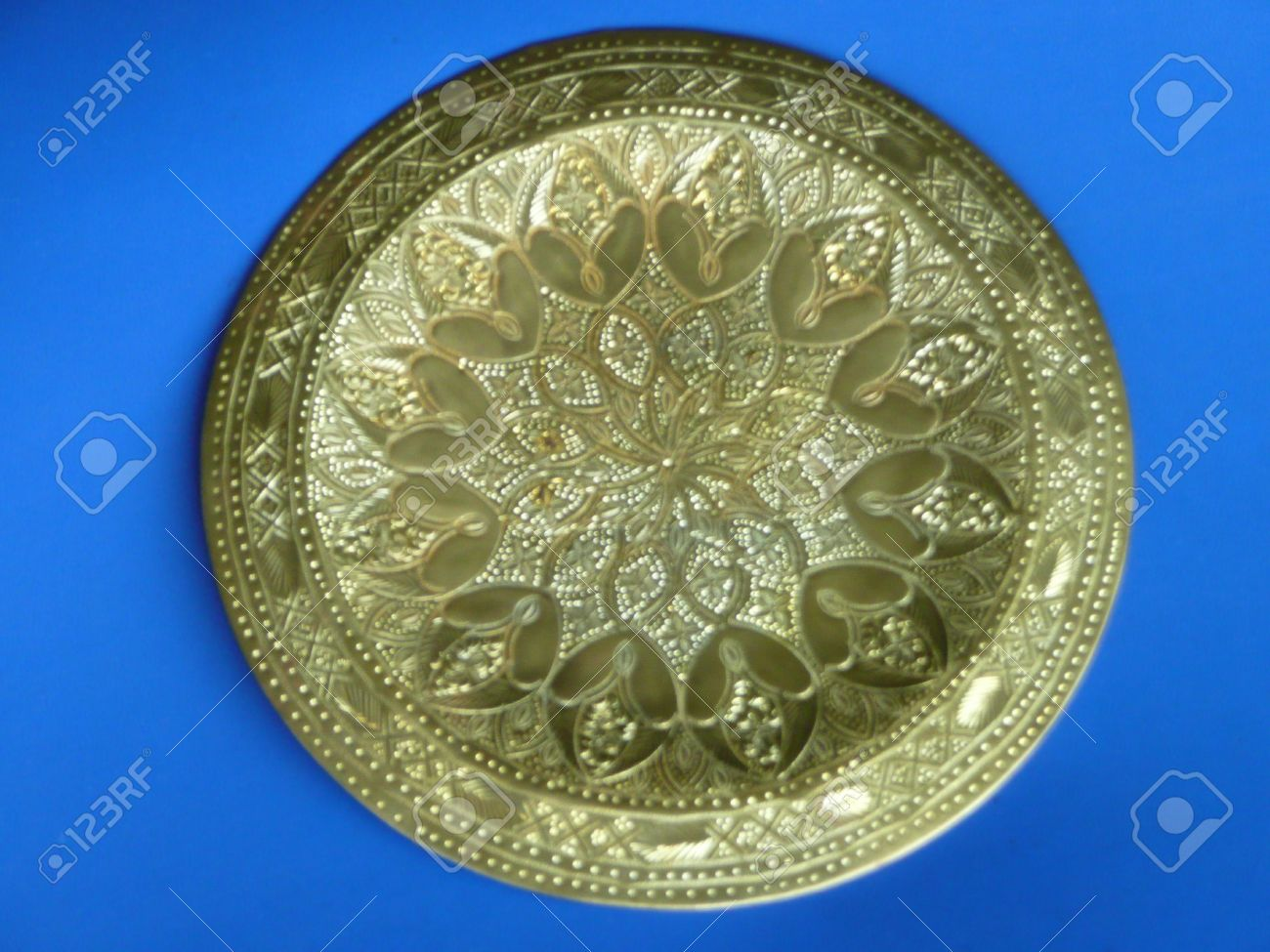 ornate imported brass decorative wall plate hanging stock photo - Decorative Wall Plates
