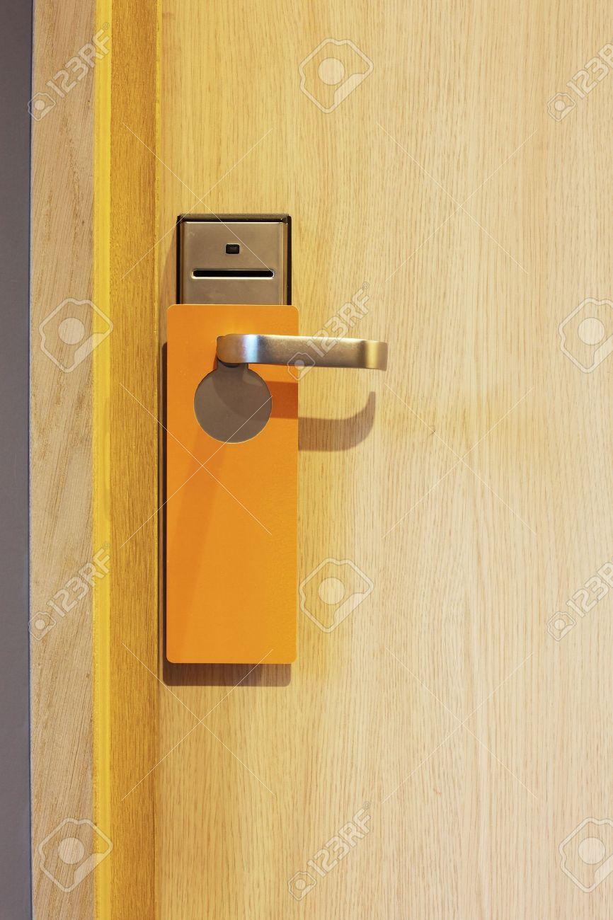 hotel door with orange card to avoid disturbing Stock Photo - 6647322