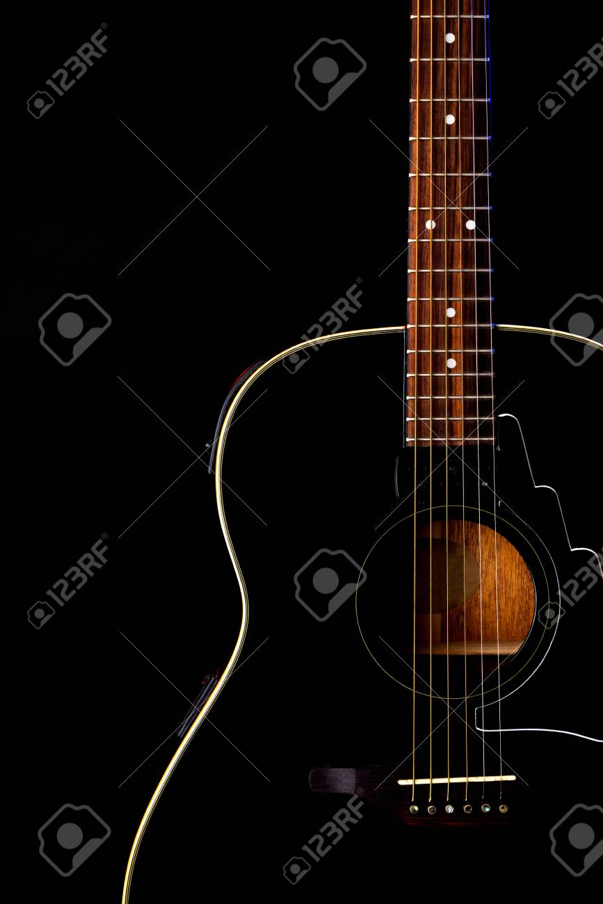 musical instrument wood acoustic six-string guitar isolated on blackbackground - 125226054