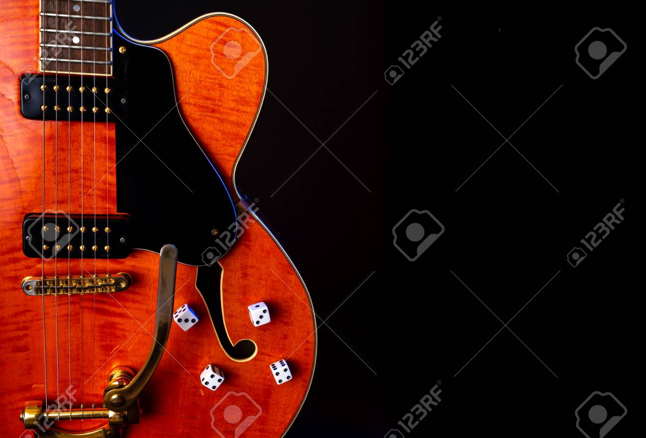 Vintage Electric Guitar, Orange flame maple, 6 String isolated on black - 125226056