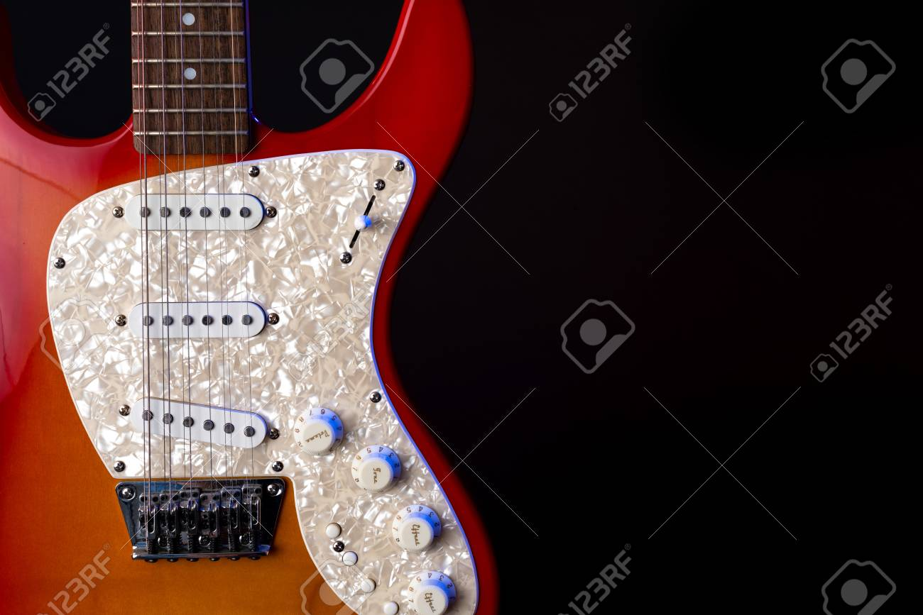 musical instrument wooden six-string guitar red isolated on blackbackground - 125226070