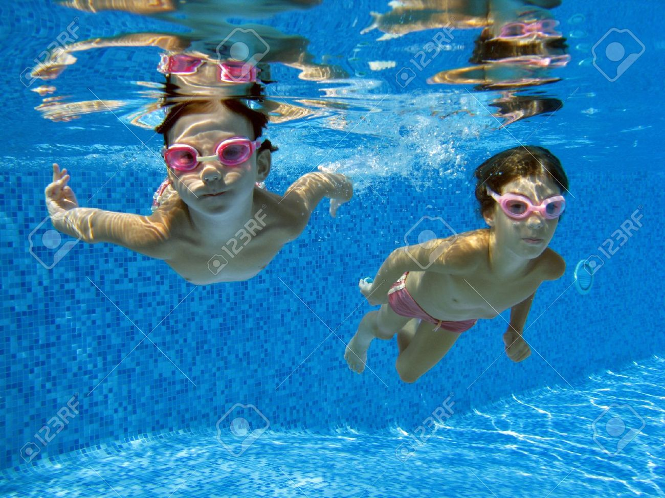 Two Underwater Girls In Swimming Pool Stock Photo Picture And Royalty Free Image Image 9330127